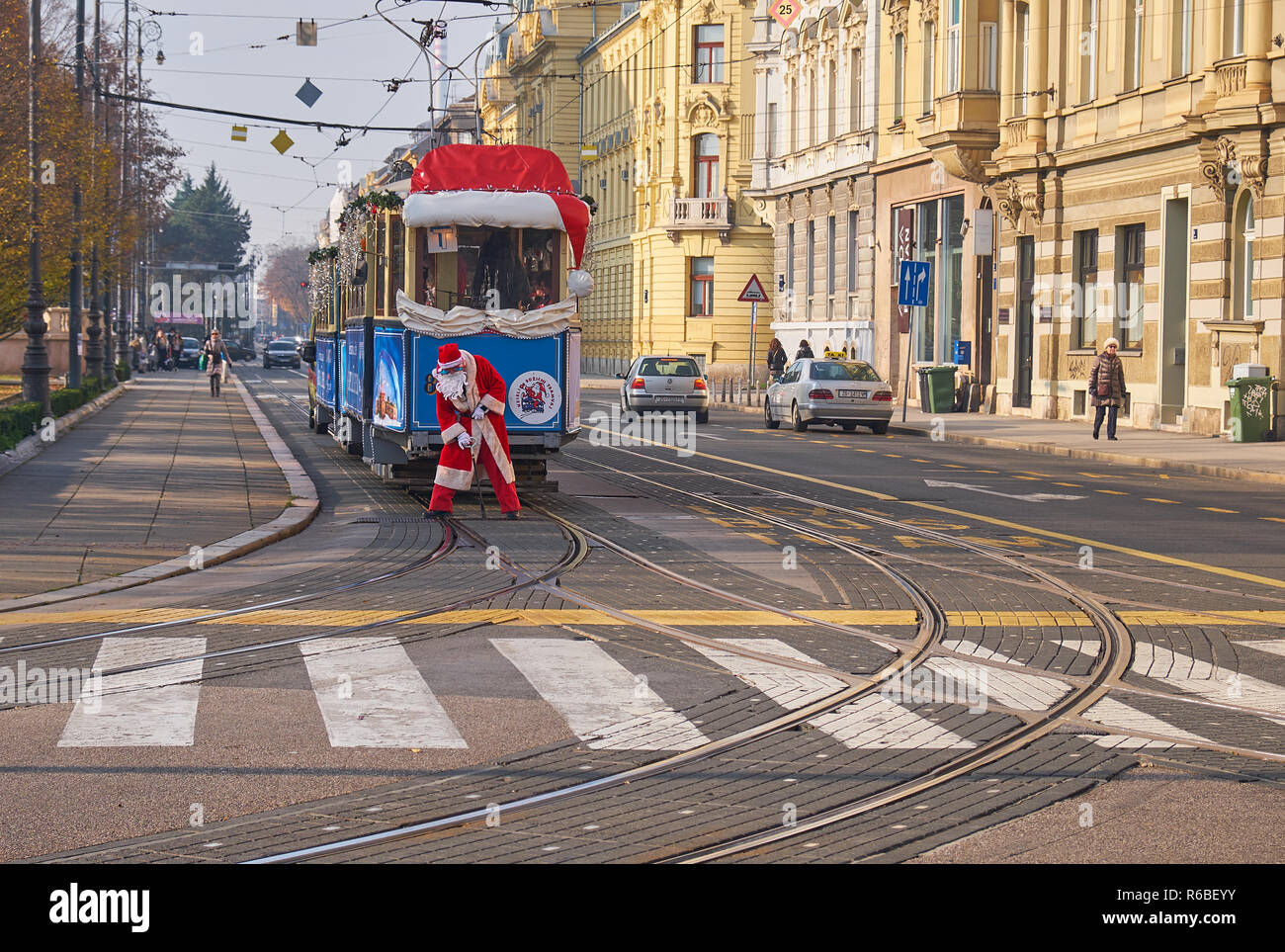 Santa operating tracks for Santa Claus tram, as part of the Advent Market celebration in Zagreb, going through the streets of the capital Stock Photo