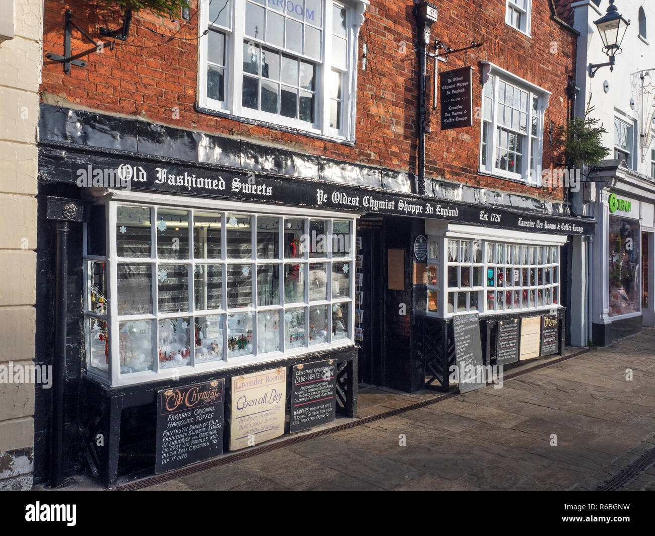 The Oldest Chemist Shop in England and Lavender Tea Rooms Market Place Knaresborough North Yorkshire England Stock Photo