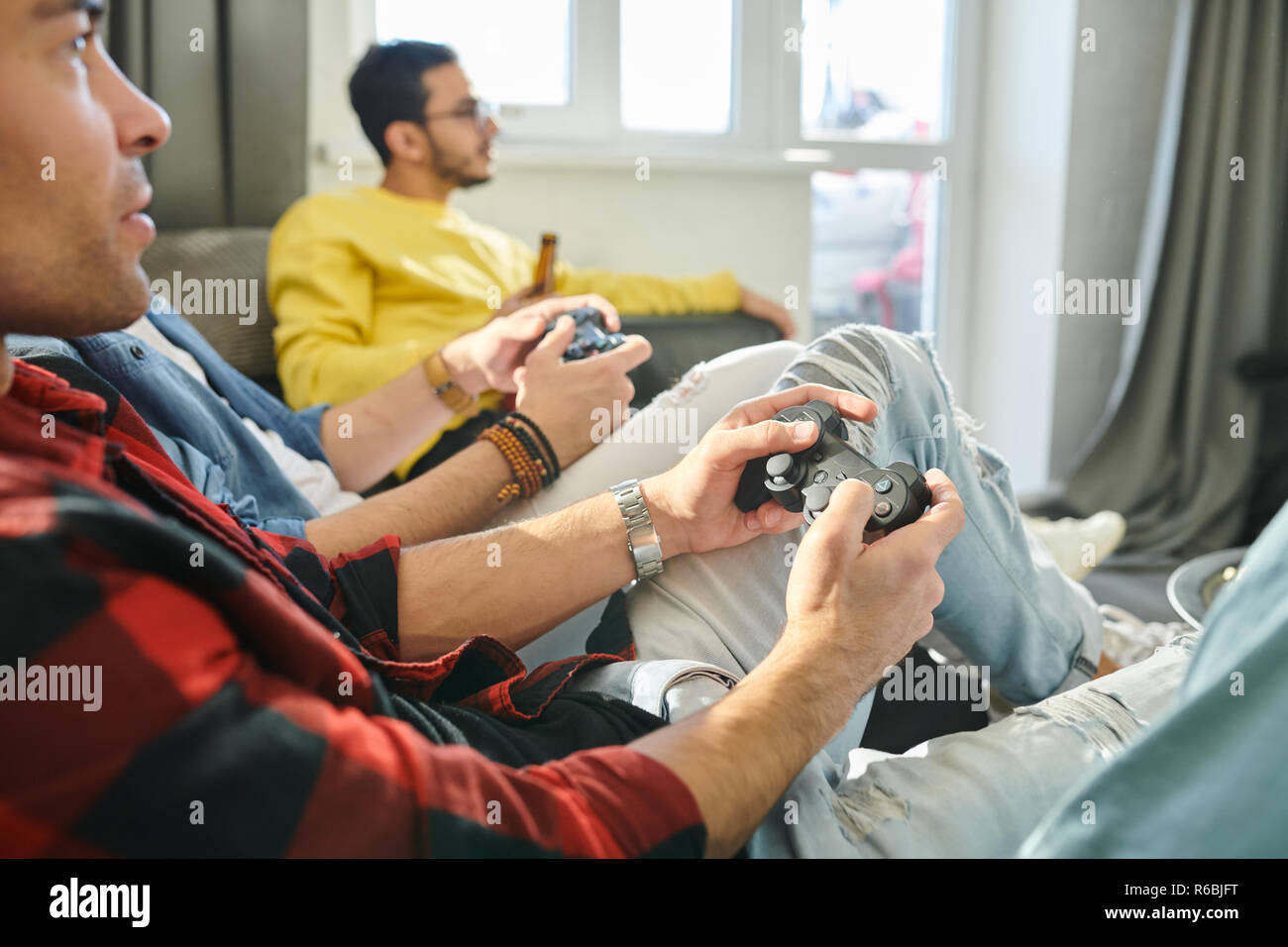 Men playing games with joystick - Stock Image