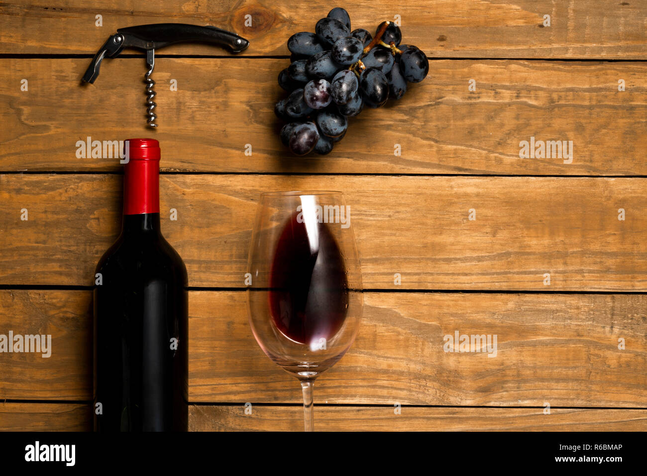 dae54d72d9e0d9 Glasses of wine bottle corks and opener on wooden background. Top view with  copy space.