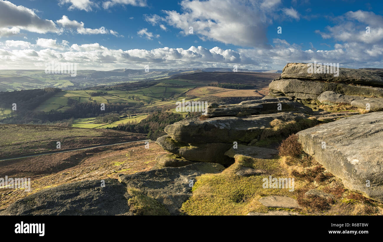 This is the superb view from Stanage Edge which is located in the High Peak area of the Peak District Nation Park. It was an incredibly windy late Feb - Stock Image