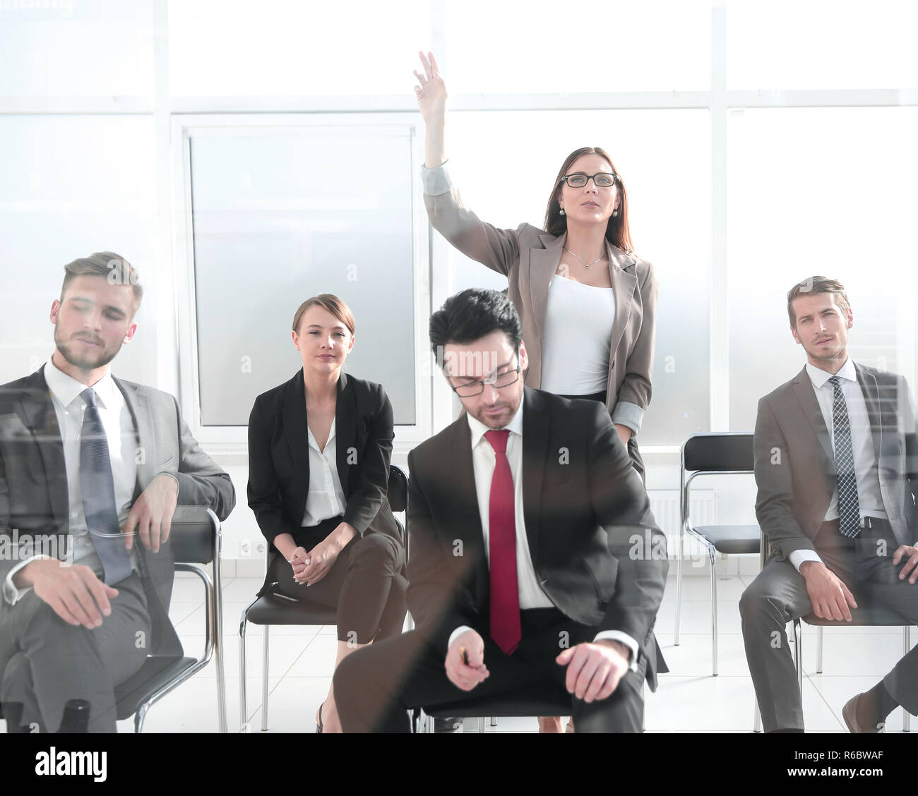 The team is listening and asking the questions. - Stock Image