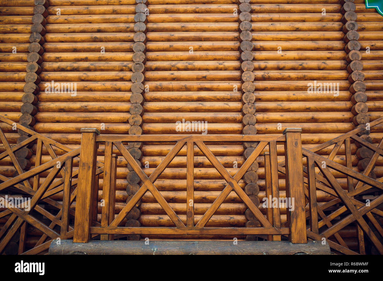 Log cabin ceiling and staircase from upper floor. - Stock Image