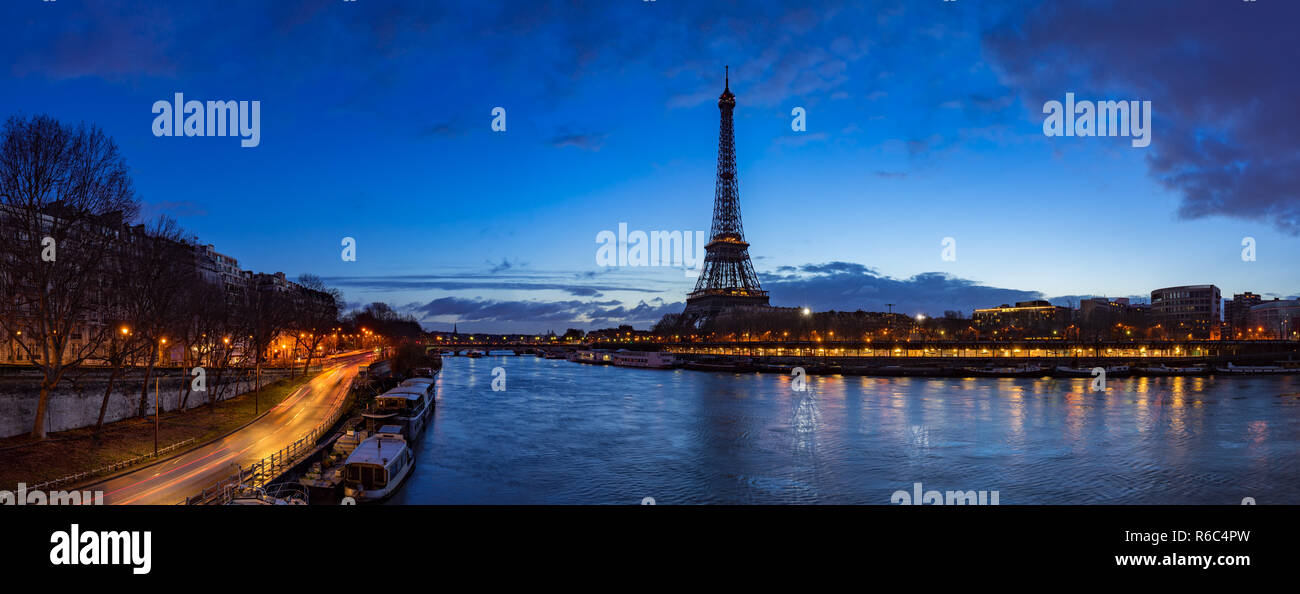 Eiffel Tower and  Seine River banks in early morning light. Panoramic view in Paris, France - Stock Image