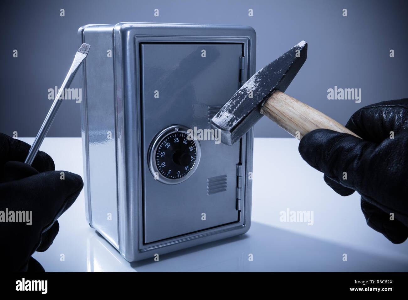 Burglar Cracking Safe Stock Photos & Burglar Cracking Safe