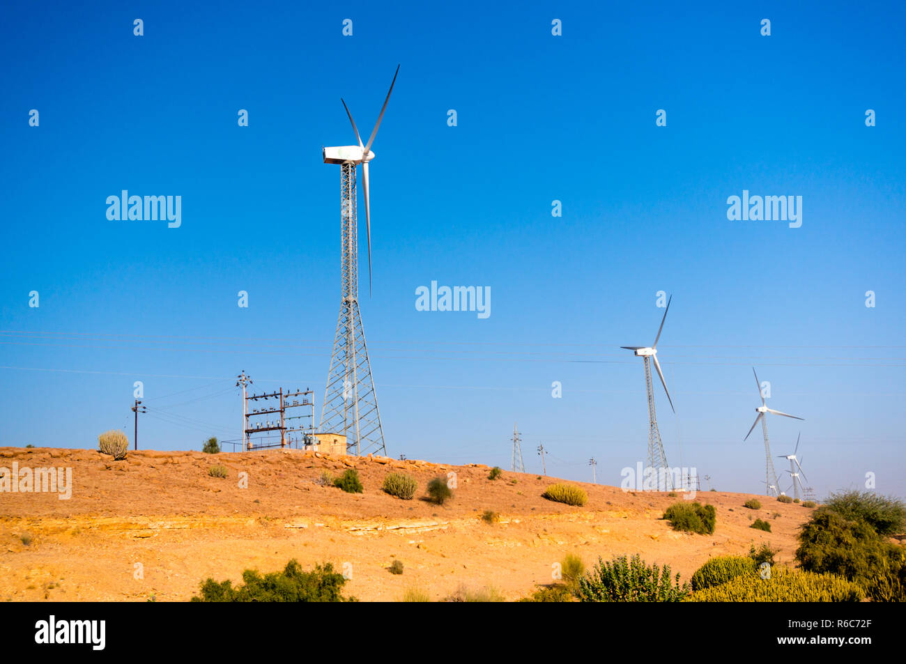 Windmills in the desert of Rajasthan near Jaisalmer  - Stock Image