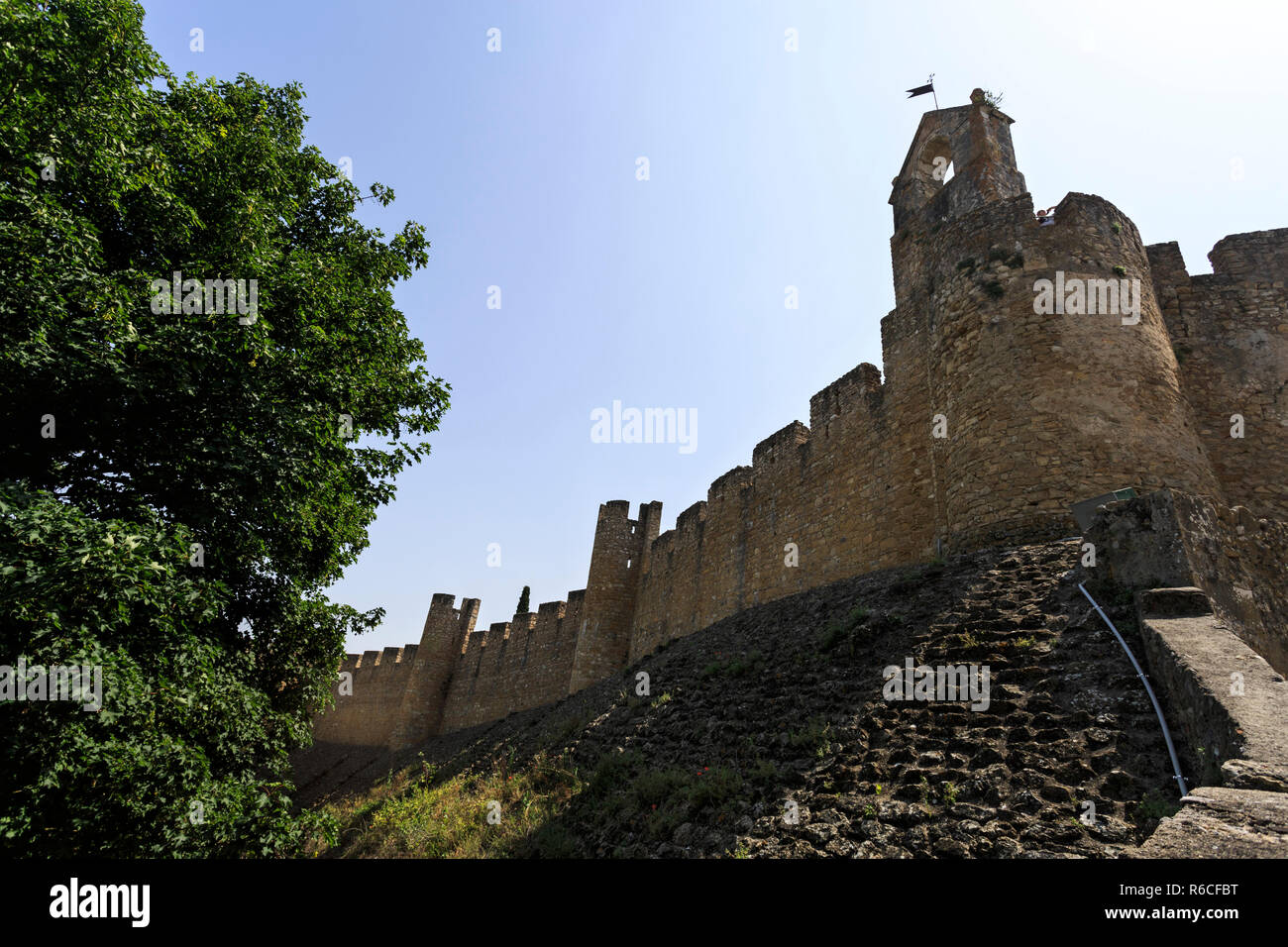 View of the medieval castle built in the 12th century by the Templar Knights to secure the border against the Moors, in Tomar, Portugal - Stock Image