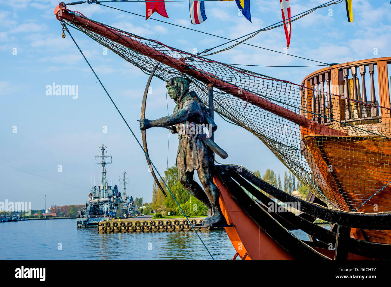 Swinoujscie Port, Poland, Figurehead With Warships Stock Photo
