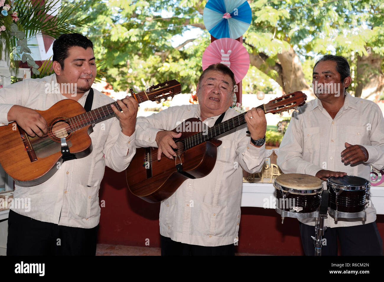 MERIDA, YUC/MEXICO - NOV 13, 2017: a 'Trio' or musical group of three players, performing at a baptism party. - Stock Image