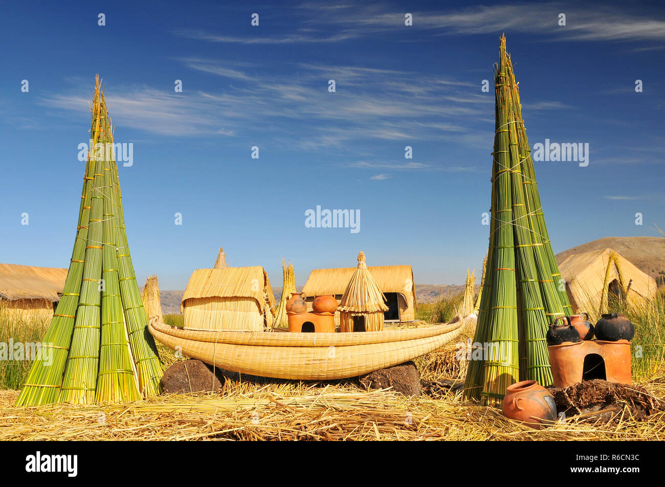Reed Boat On Island Of Uros Titicaca (Titiqaqa) Is A Lake In The Andes On The Border Of Peru And Bolivia - Stock Image