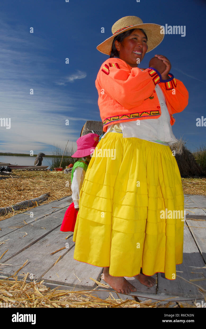 Peru, South America, Titicaca Lake, Uros Indian, Uros Ayamaras, Floating Island, Woman - Stock Image
