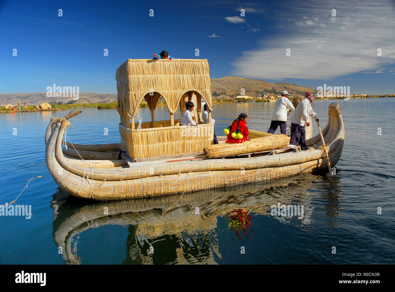 Traditional Uros Boat In Lake Titicaca Peru Floating Island - Stock Image