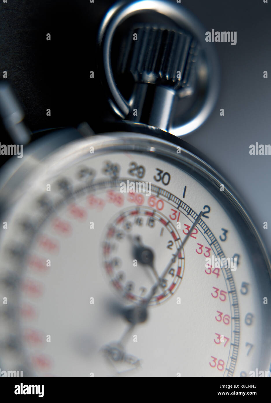 Close up cropped soft focus image of a metal stopwatch - Stock Image
