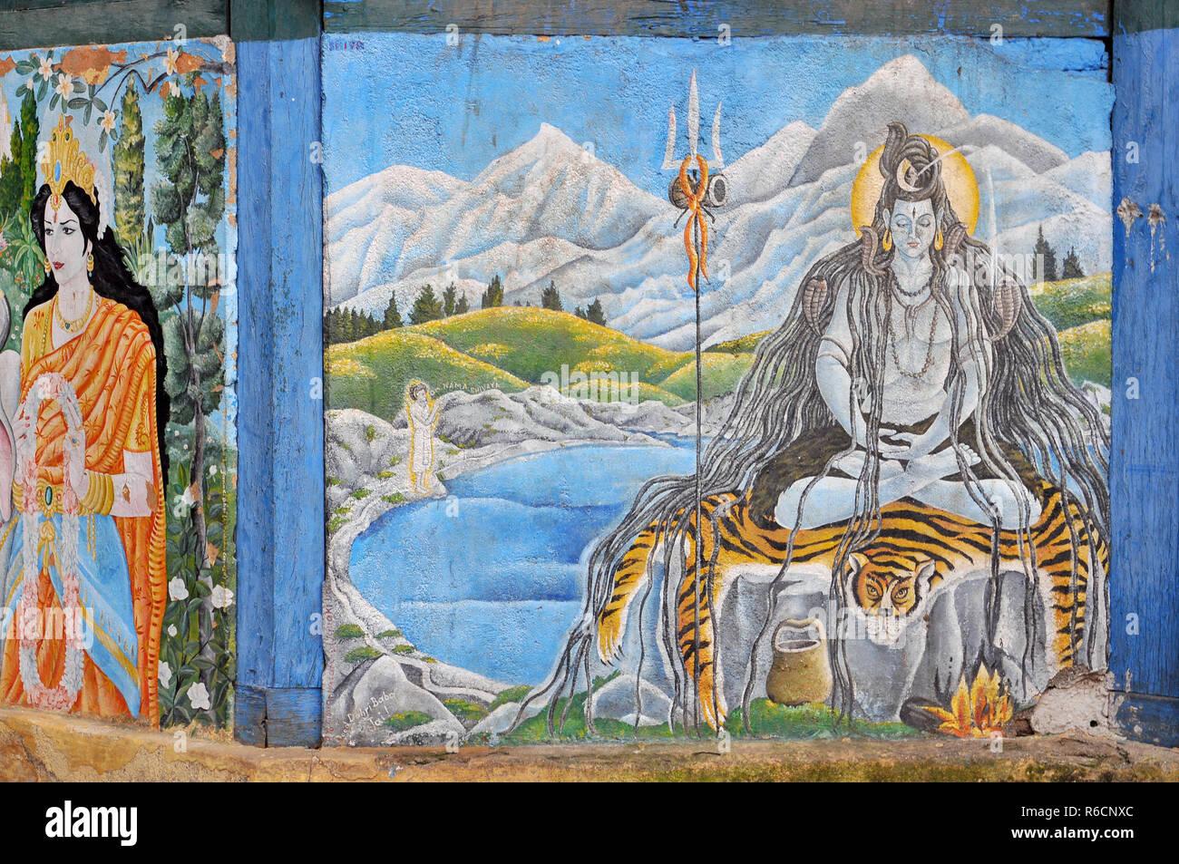 Nepal, Kathmandu, A Painting Of The Hindu God Shiva Meditating In The Himalayas Adorns The Walls Of A Temple At Kathmandu'S Pashupatinath - Stock Image