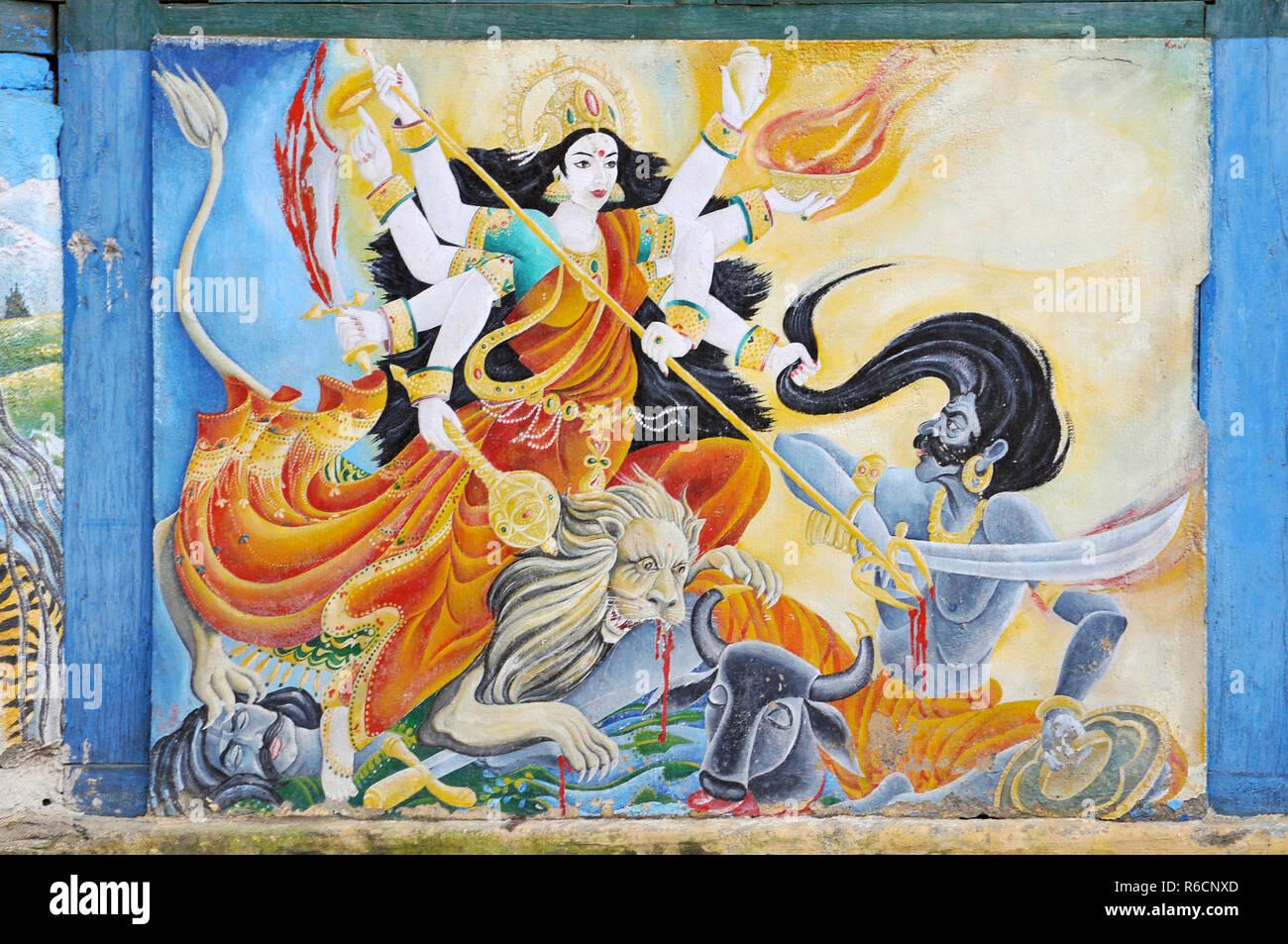 Nepal, Kathmandu, A Painting Of The Hindu Goddess Durga Adorns The Walls Of A Temple At Kathmandu'S Pashupatinath - Stock Image