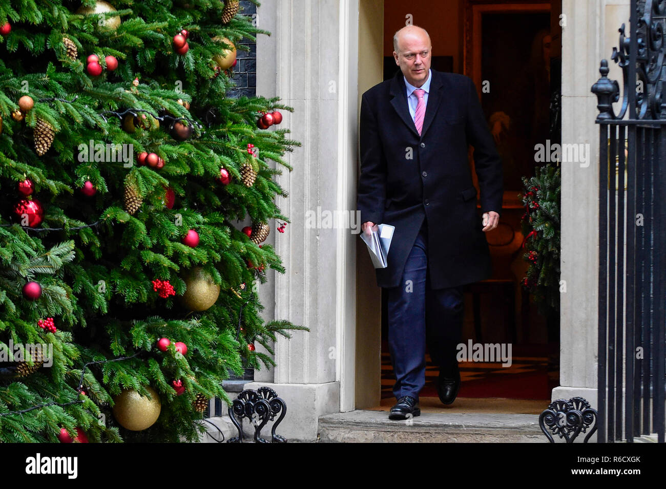 London, UK. 4th Dec, 2018. British Transport Secretary Chris Grayling leaves 10 Downing Street after a cabinet meeting in London, Britain on Dec. 4, 2018. British MPs on Tuesday voted by 311 to 293 to find ministers in contempt of parliament over their failure to publish the full legal advice on the Brexit deal. Credit: Stephen Chung/Xinhua/Alamy Live News - Stock Image