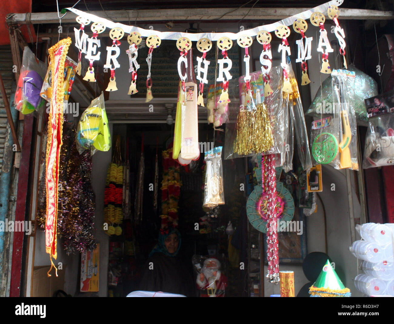 Srinagar, Kashmir. 5th Dec 2018. Santa Claus at shop. Christmas is being celebrated with religious fervor across Jammu and Kashmir on Tuesday 25th December. Churches across the Valley are decorated with buntings and lights.  Christmas is celebrated as commemoration of the birth of Jesus Christ universally by the Christian community Credit: sofi suhail/Alamy Live News - Stock Image