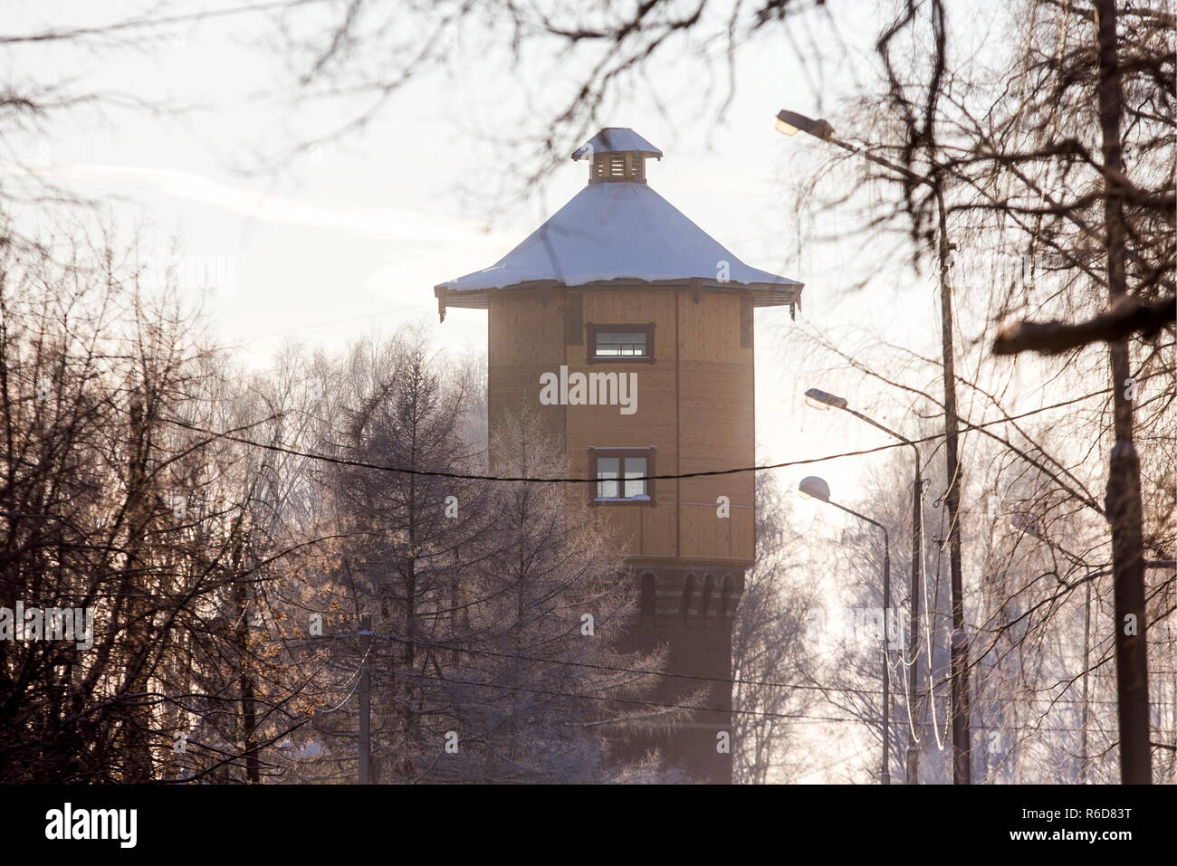 TOMSK, RUSSIA - DECEMBER 5, 2018: A former water tower transformed into a home by local resident, Alexander Lunev (not in picture), at Devyatnadstataya Gvardeiskaya Street in the city of Tomsk; the 120 years old former water tower measures some 25 metres in height and includes 6 storeys, an attic, and an observation platform. Danila Shostak/TASS - Stock Image