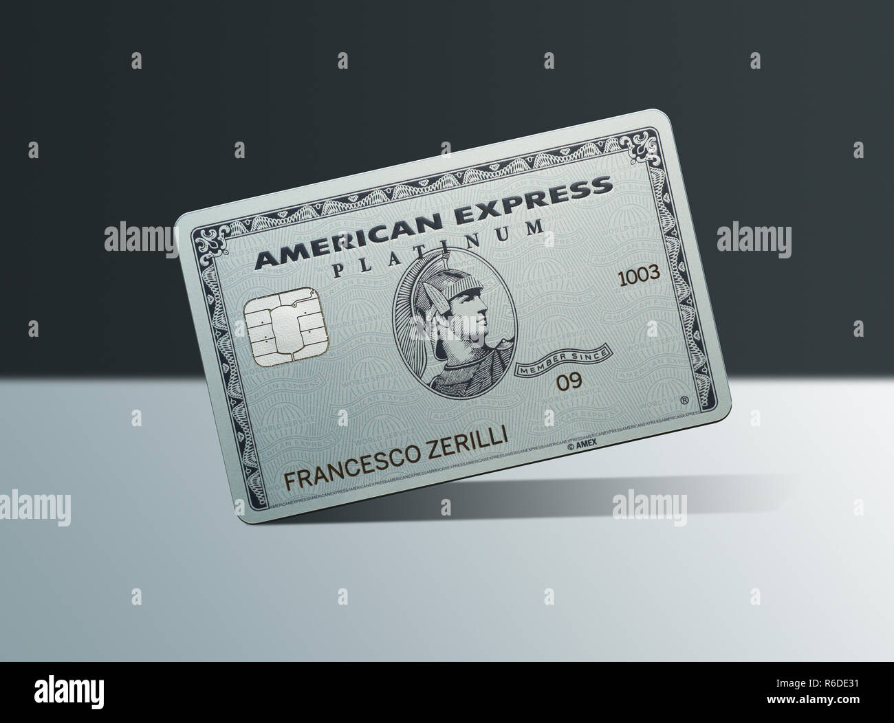 Close up of American Express platinum card, tilted on white surface - Stock Image