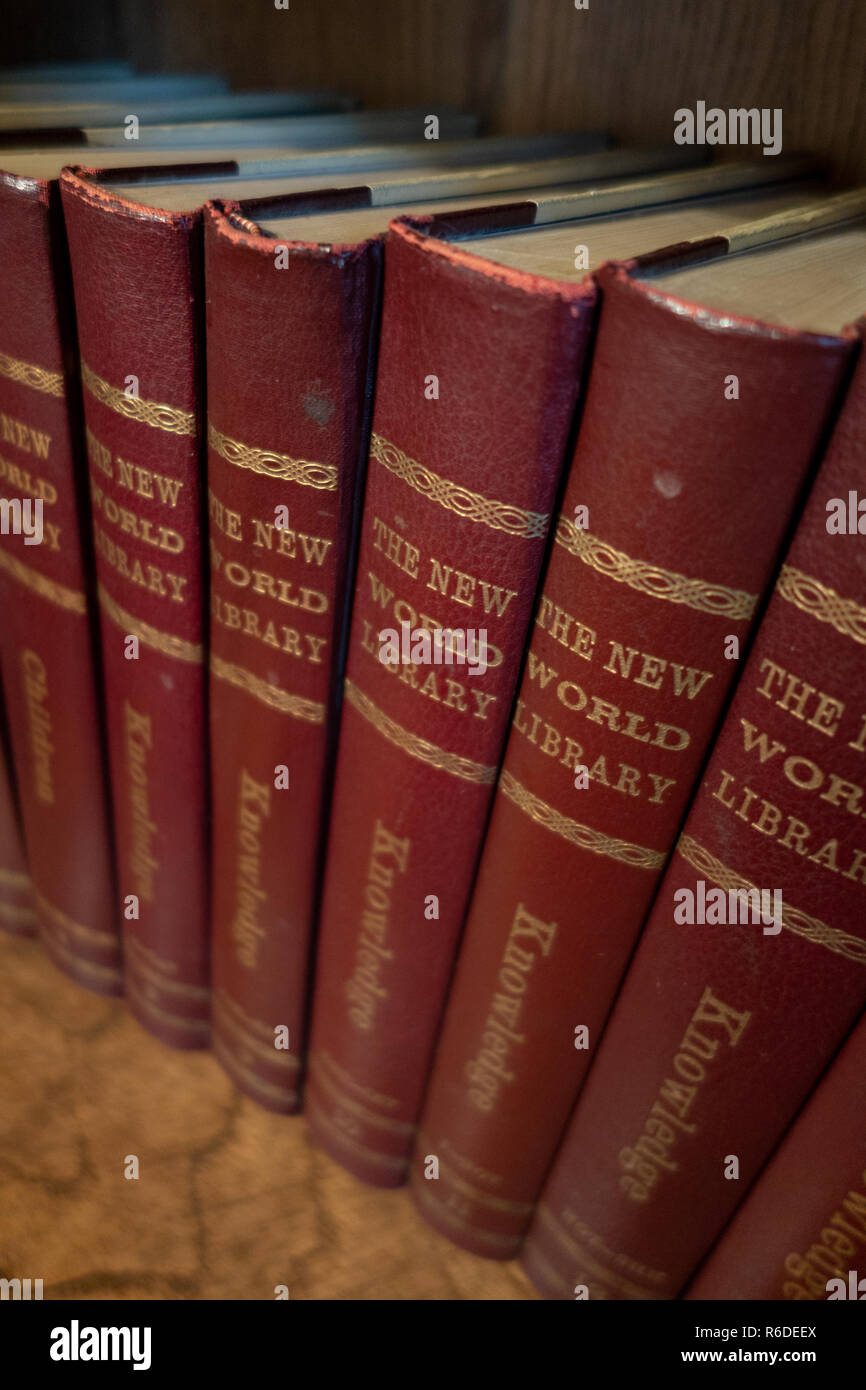 Set of New World Library Books illustrated Encyclopedia on a book shelf in an English house - Stock Image