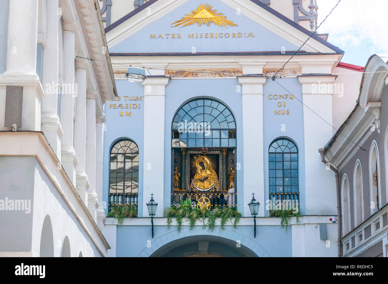 The Chapel Of Our Lady Of The Gate Of Dawn Is In The Middle Behind The Glass Window Vilnius, Lithuania - Stock Image