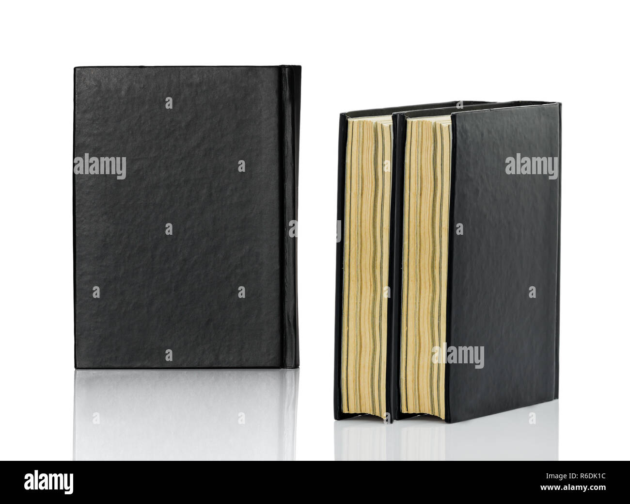 Closed black book is laying on white background - Stock Image