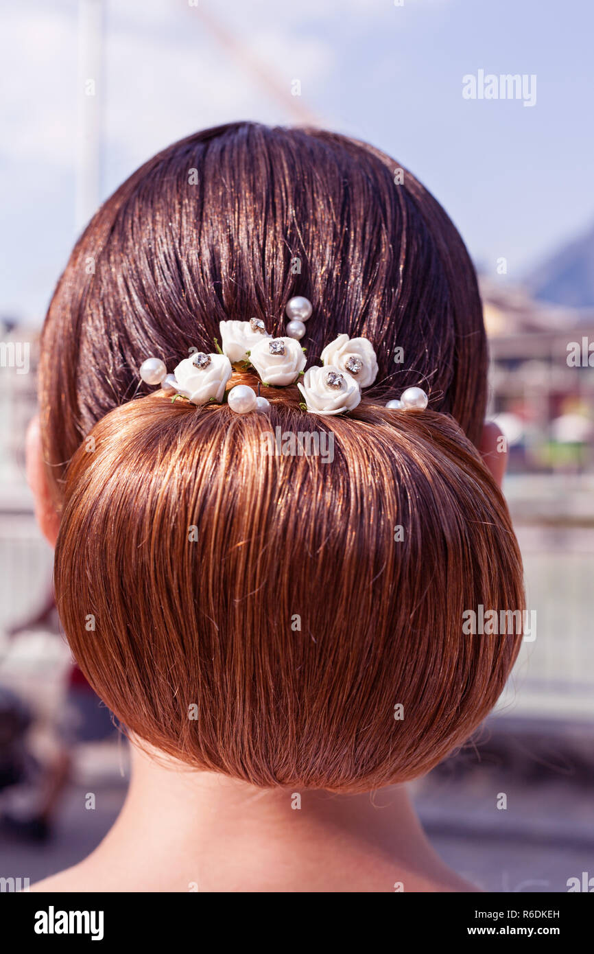 Back View Of A Female Blond Head With A Braided Bridesmaid - Stock Image