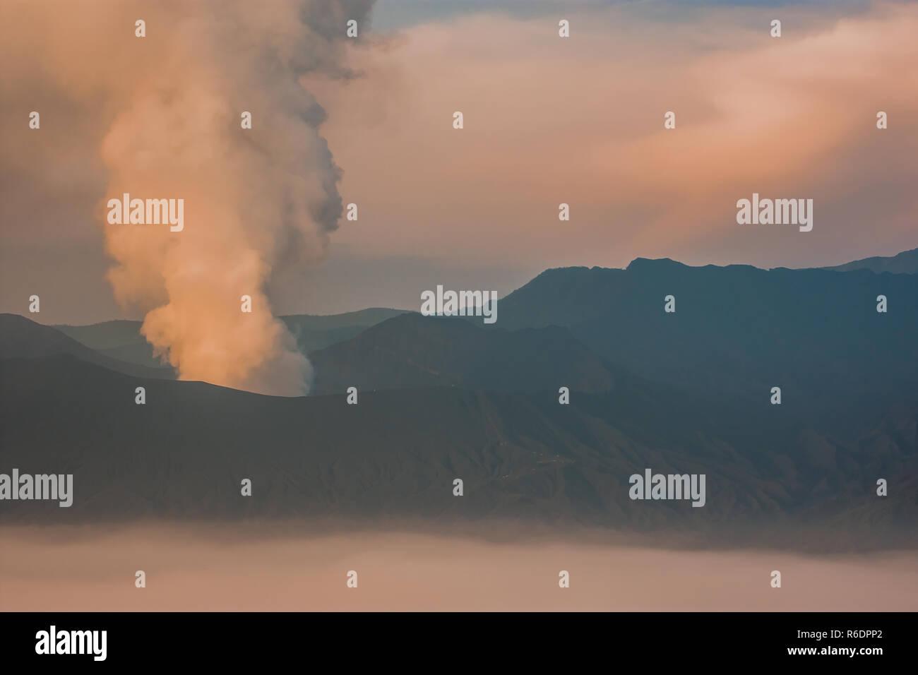 Erruption Smoke on Bromo Vulcano Java Indonesia - Stock Image