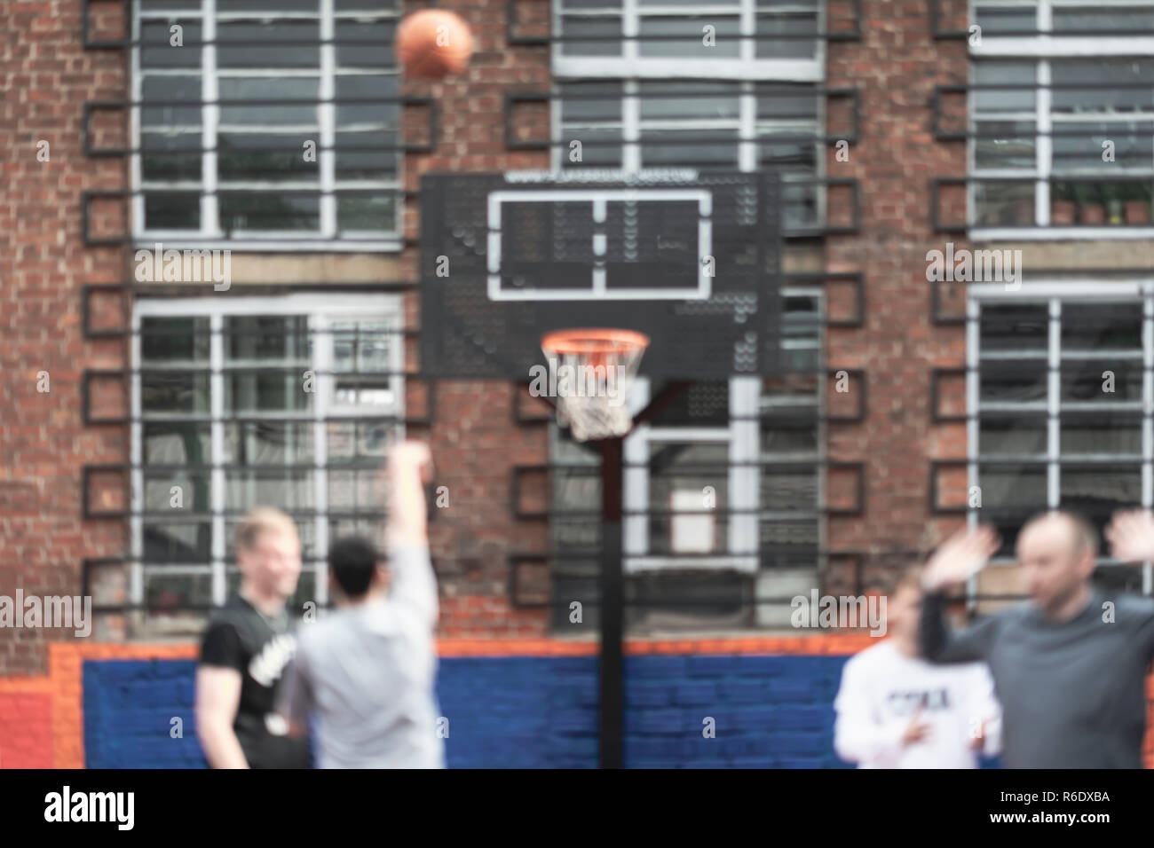 Street basketball. Youth, friends, play outside. Blurred background. Active lifestyle and sports among young people Stock Photo