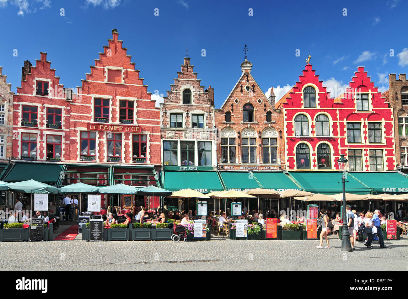 Medieval Style Shops And Restaurants Around The Market Place (Grote Markt) In Bruges Belgium Stock Photo