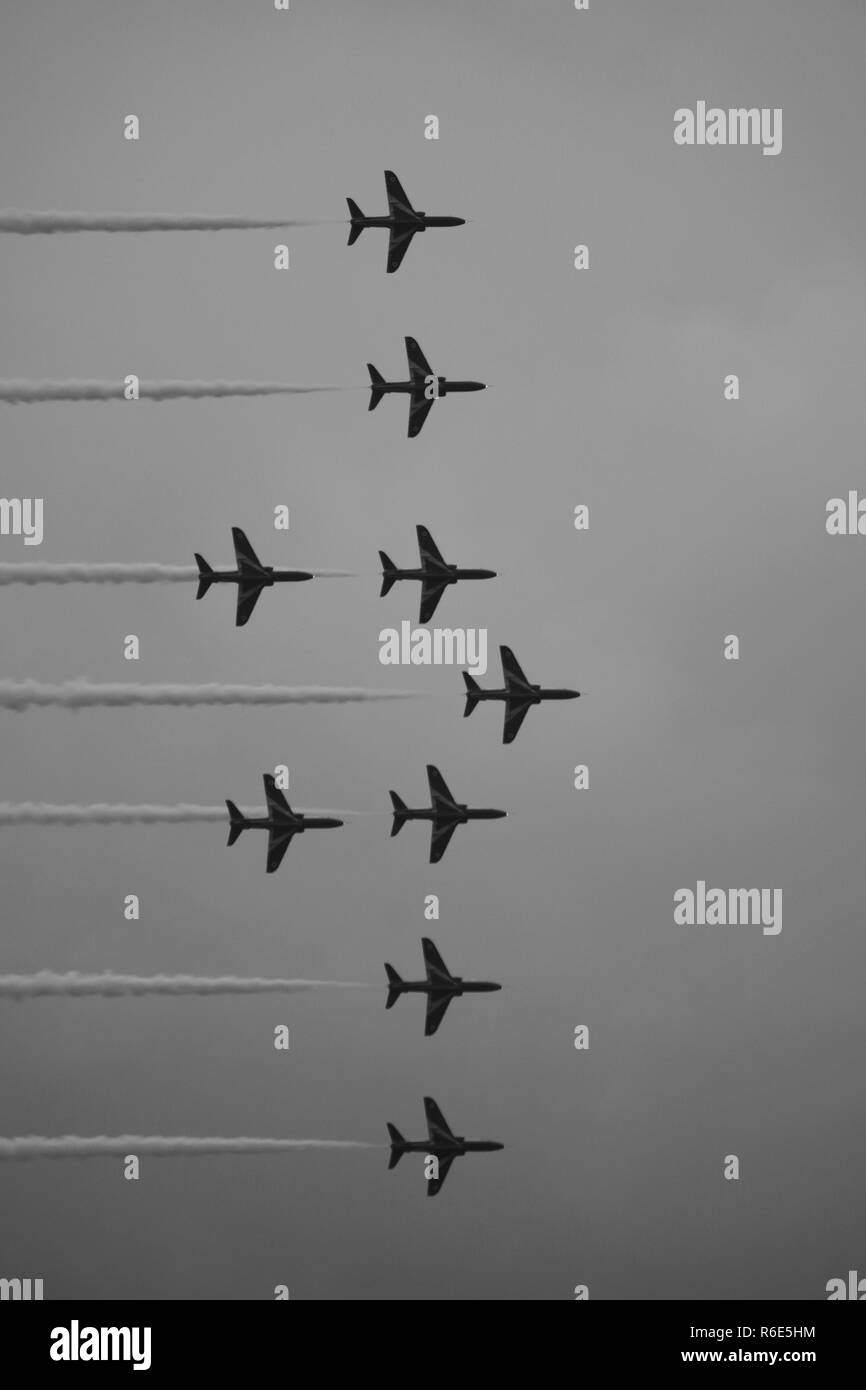 The Red Arrows, Royal Air Force Aerobatic Team. Displaying at Sidmouth Regatta 2018, against a Moody Grey Sky. East Devon, UK. - Stock Image