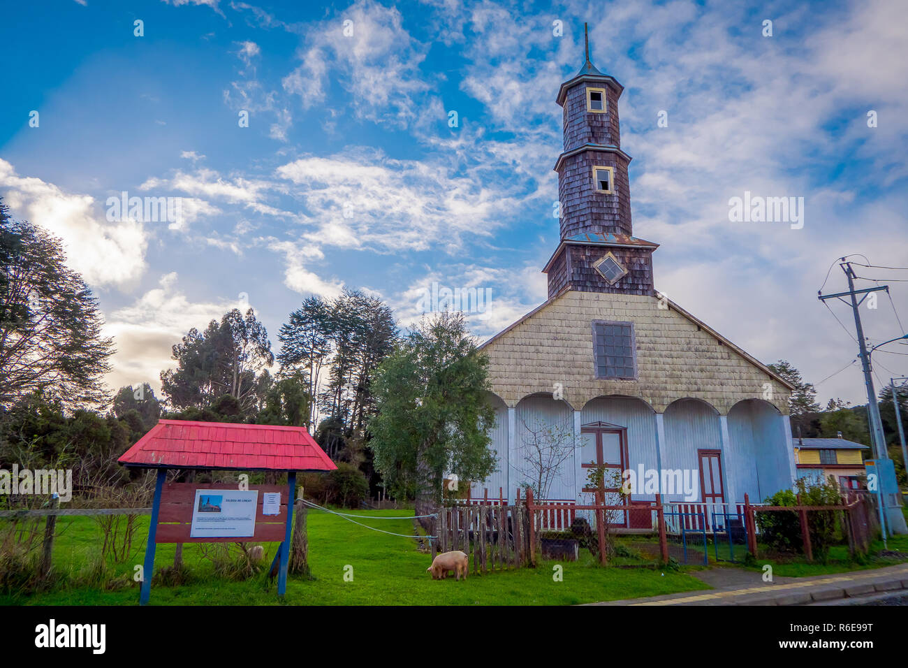 CHILOE, CHILE - SEPTEMBER, 27, 2018: Gorgeous view of Sunlit wooden Church of our Lady of Patrocinio on Chiloe Island - Stock Image