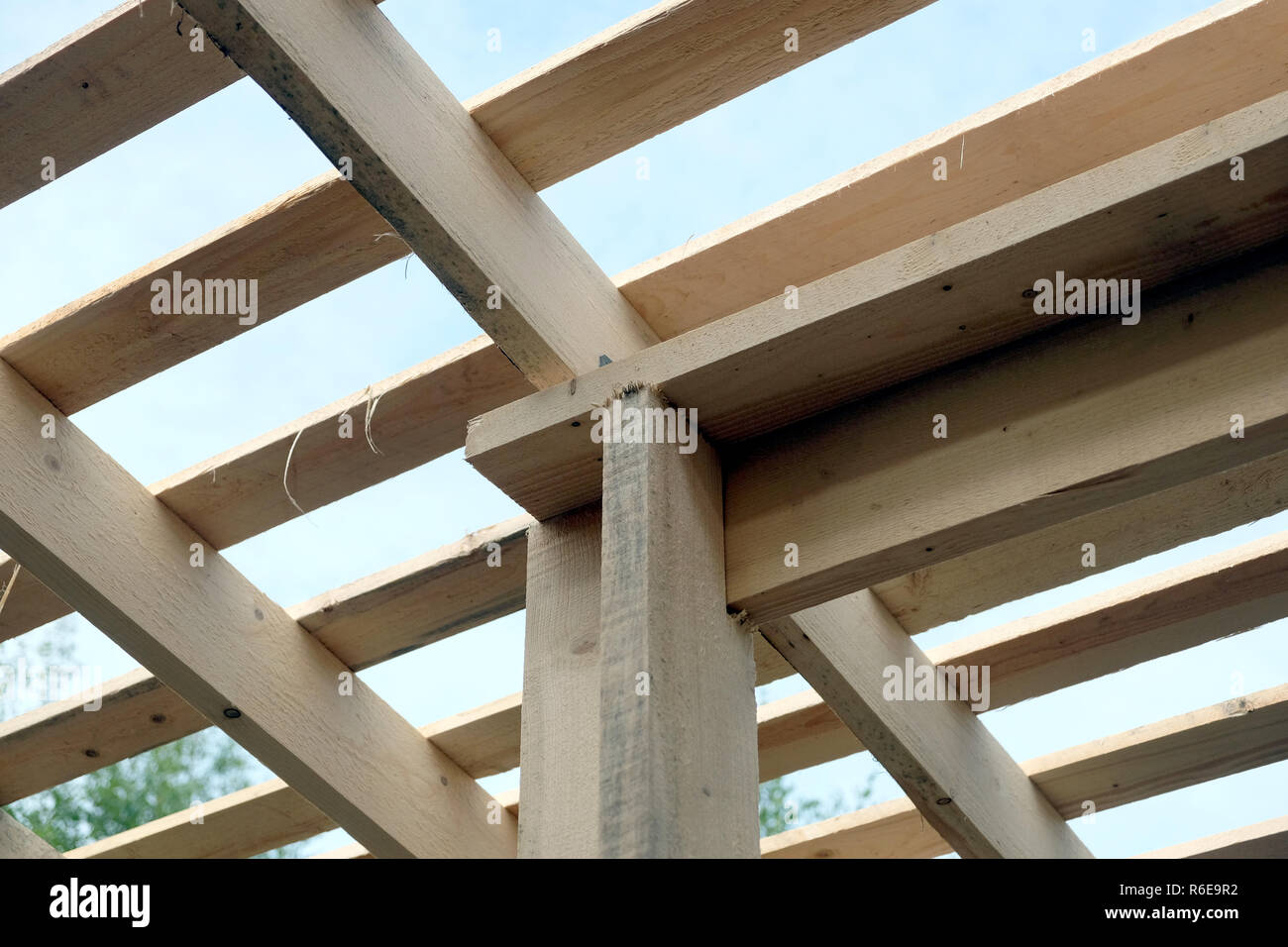 Roof lathing mounting inside house. Wooden country house construction - Stock Image