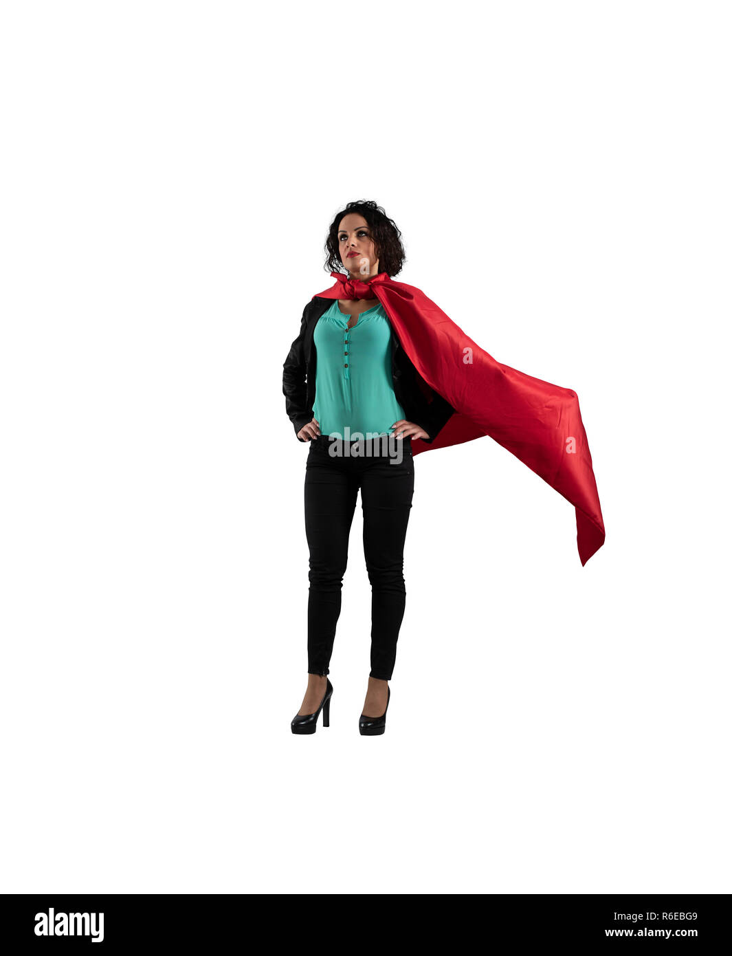 Successful businesswoman acts like a super hero. isolated on white background - Stock Image