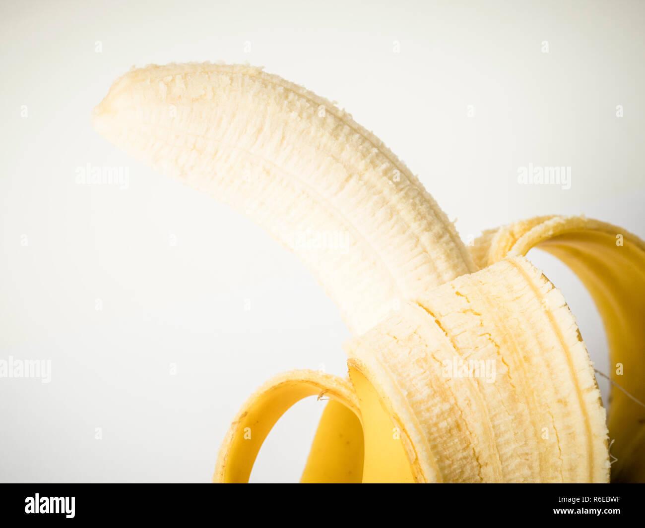 Close up of peeled banana - Stock Image