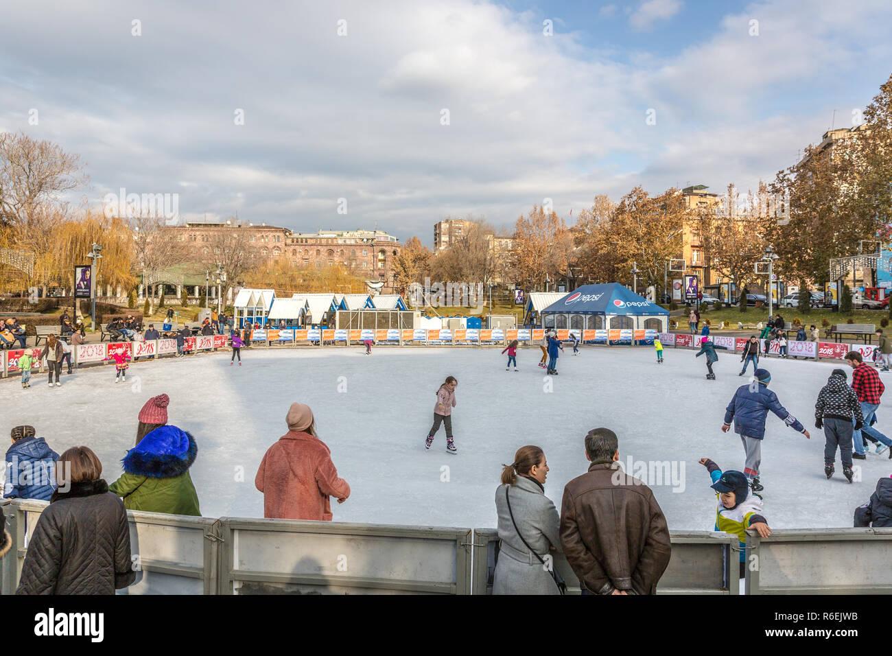 Yerevan, Armenia - Jan 8th 2018 - Tourists and locals enjoying an ice-skating park in Yerevan, winter time in Armenia Stock Photo