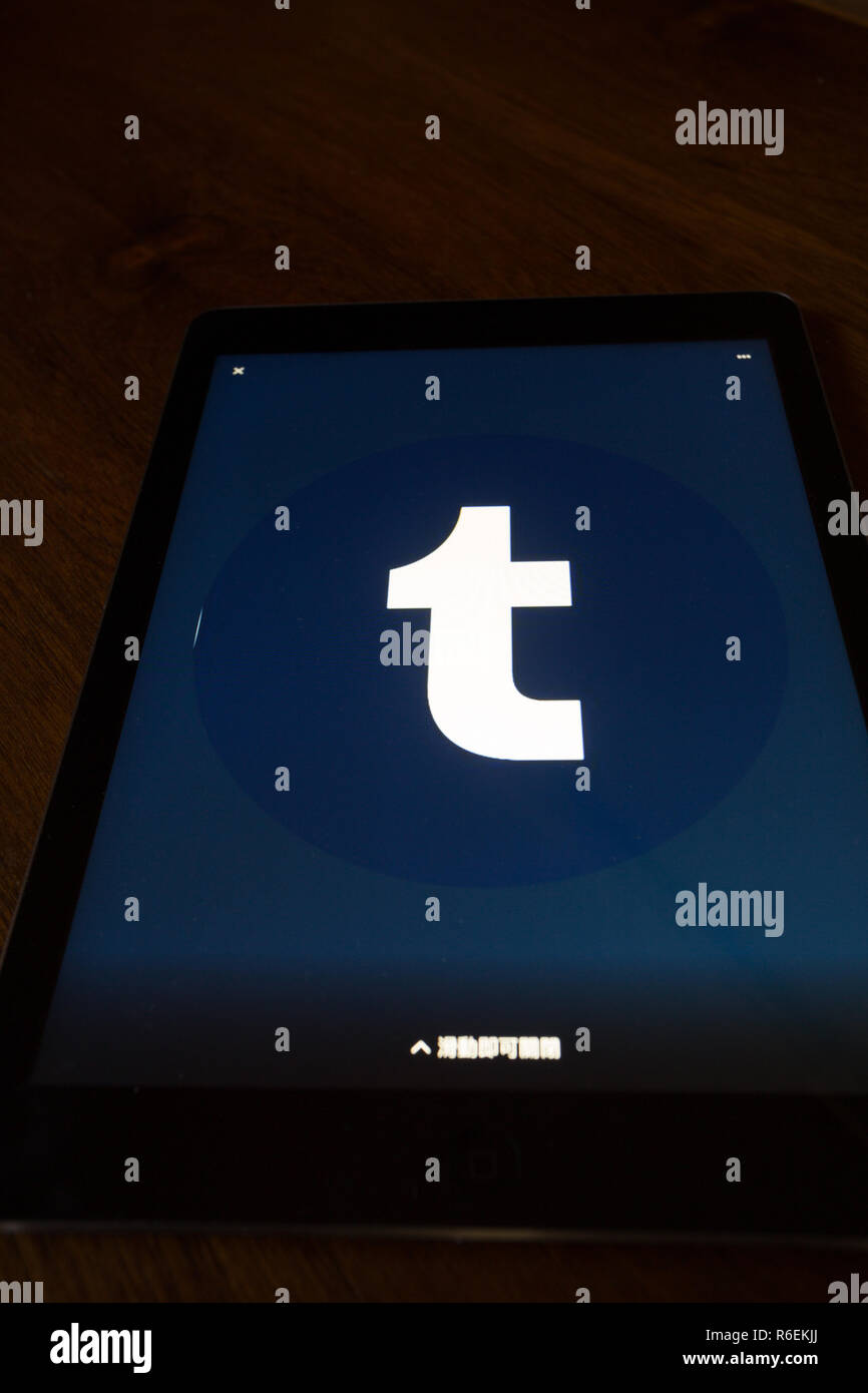 Tumblr, microblogging and social networking website, logo is shown on Apple iPad Air device screen - Stock Image