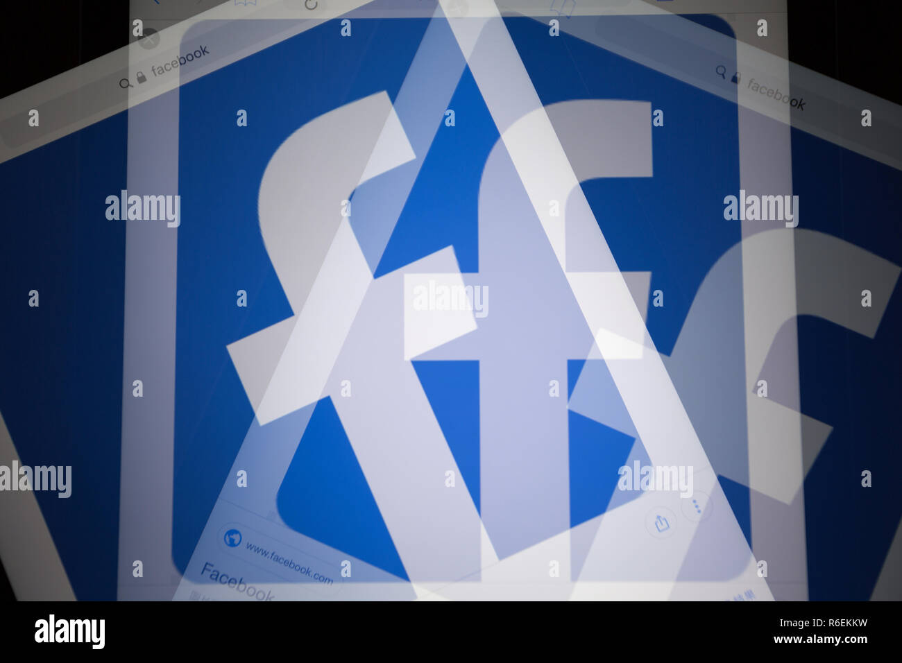 Facebook, online social media and social networking service company, logo is shown on Apple iPad Air device screen. Shoot in-camera multiple exposure - Stock Image