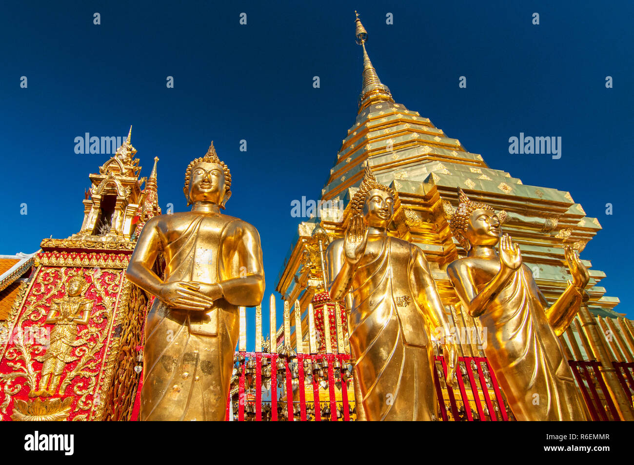 Golden Buddha Statues And A Golden Pagoda Or Chedi, Wat Phra That Doi Suthep, Chiang Mai, Thailand Stock Photo