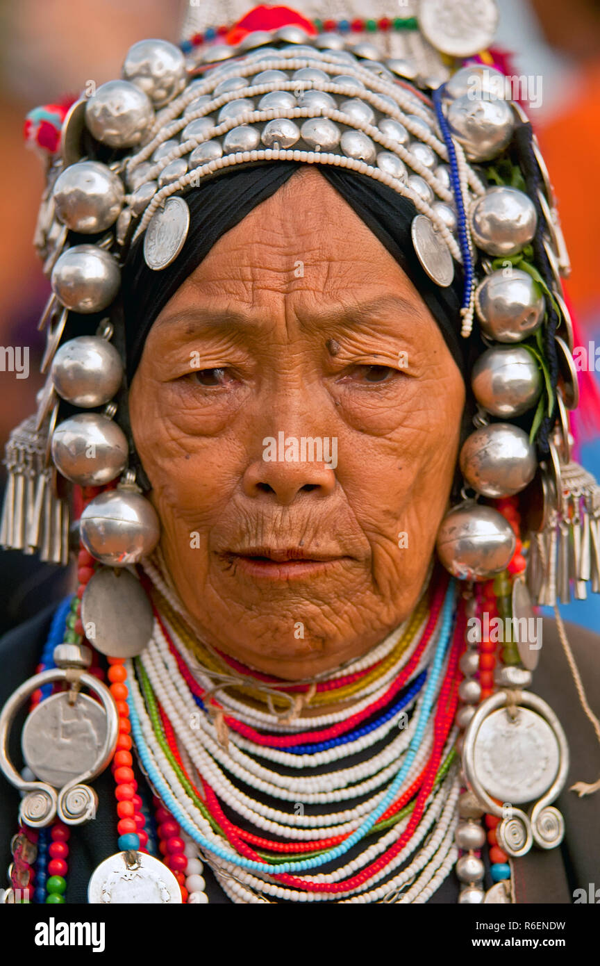 Akha Hill Tribe Woman With Traditional Headdress, Chiang Mai Province, Thailand - Stock Image
