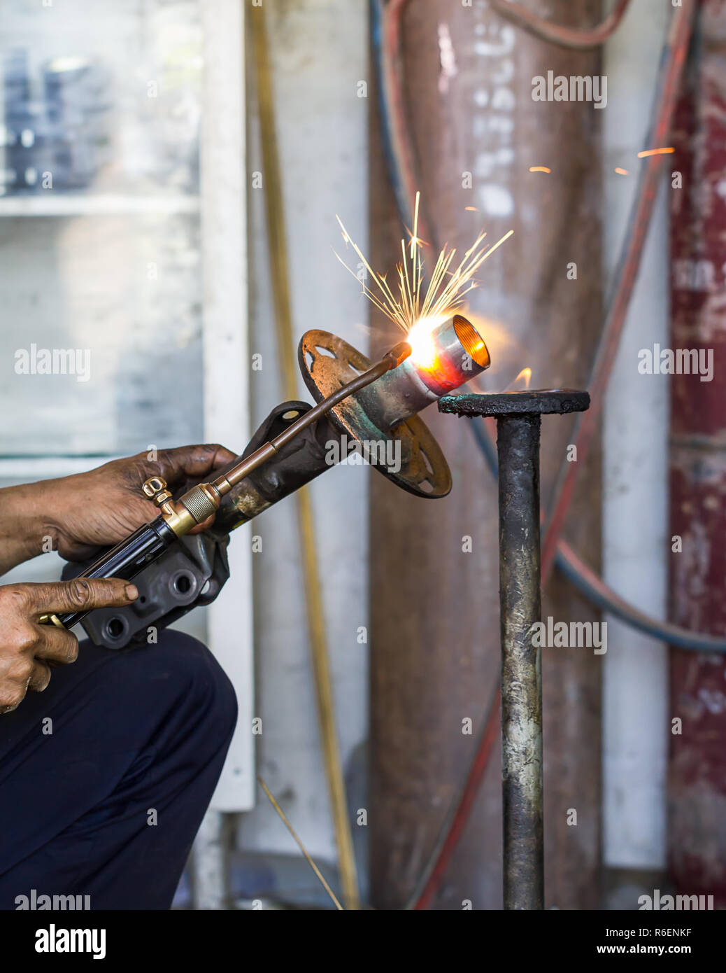 Welders were repairing Shock absorbers - Stock Image