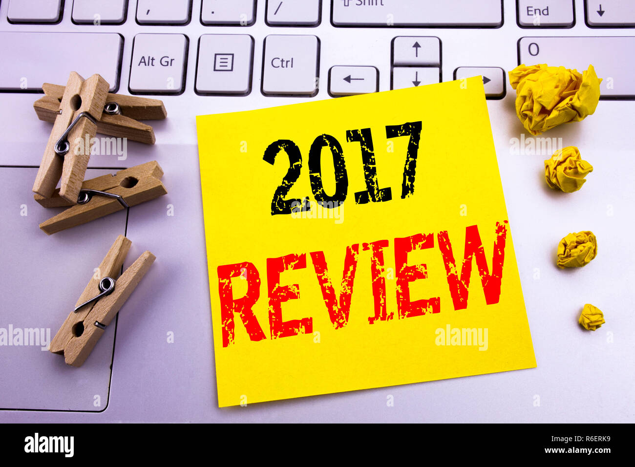 Hand writing text caption inspiration showing 2017 Review. Business concept for Annual Summary Report written on sticky note paper on the white keyboard background. - Stock Image