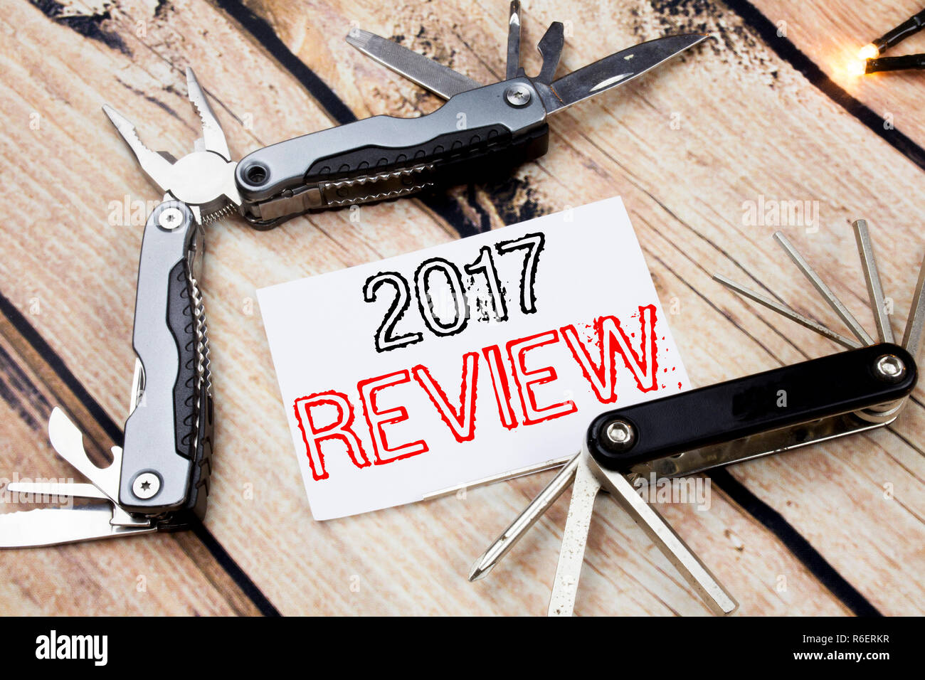 Conceptual hand writing text caption inspiration showing 2017 Review. Business concept for Annual Summary Report Written on sticky note wooden background with pocket knife - Stock Image