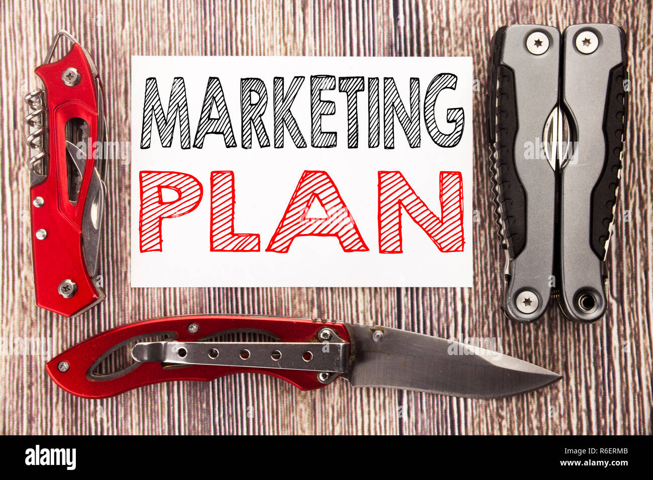 Conceptual hand writing text caption inspiration showing Marketing Plan. Business concept for Planning Successful Strategy Written on sticky note wooden background with pocket knife - Stock Image
