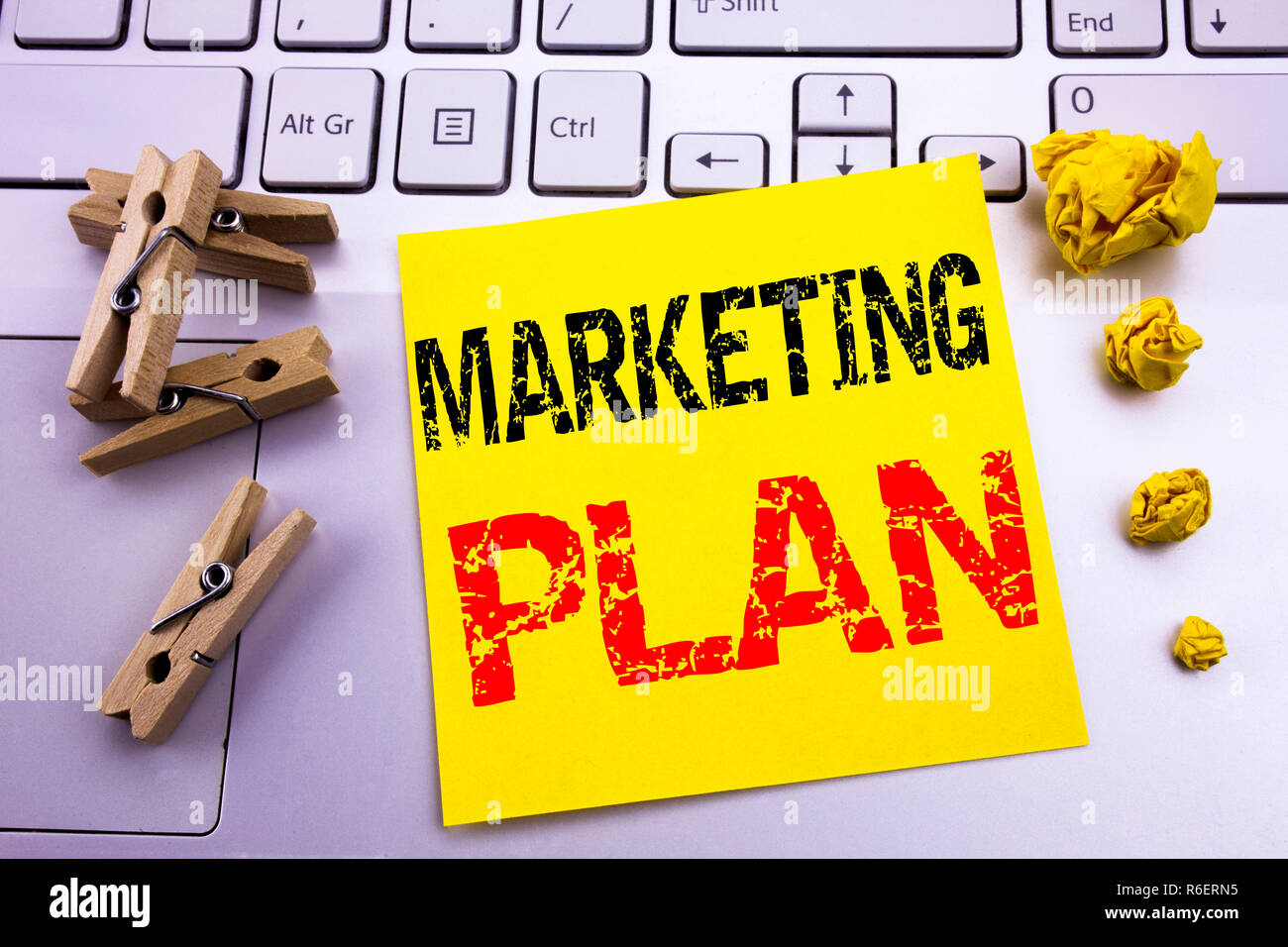 Hand writing text caption inspiration showing Marketing Plan. Business concept for Planning Successful Strategy written on sticky note paper on the white keyboard background. - Stock Image