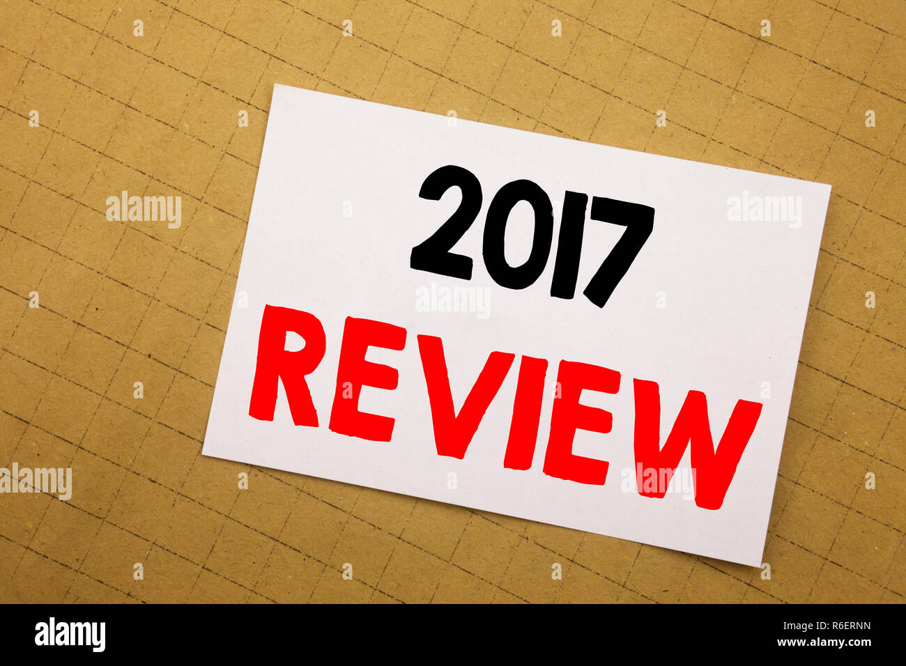 Conceptual hand writing text caption inspiration showing 2017 Review. Business concept for Annual Summary Report Written on sticky note yellow background. - Stock Image