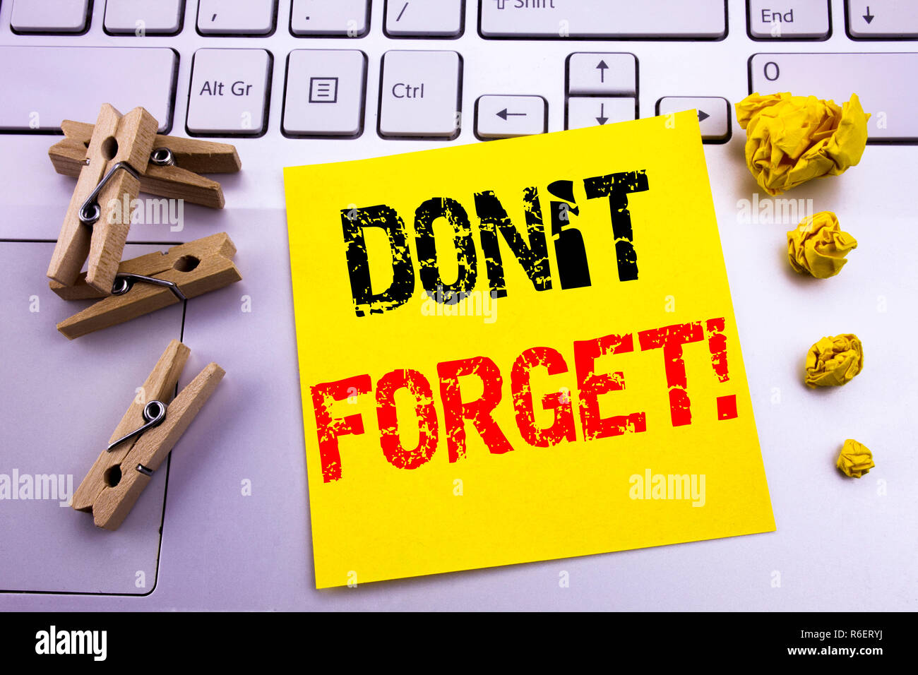 Hand writing text caption inspiration showing Do Not Forget. Business concept for Reminder Message written on sticky note paper on the white keyboard background. - Stock Image