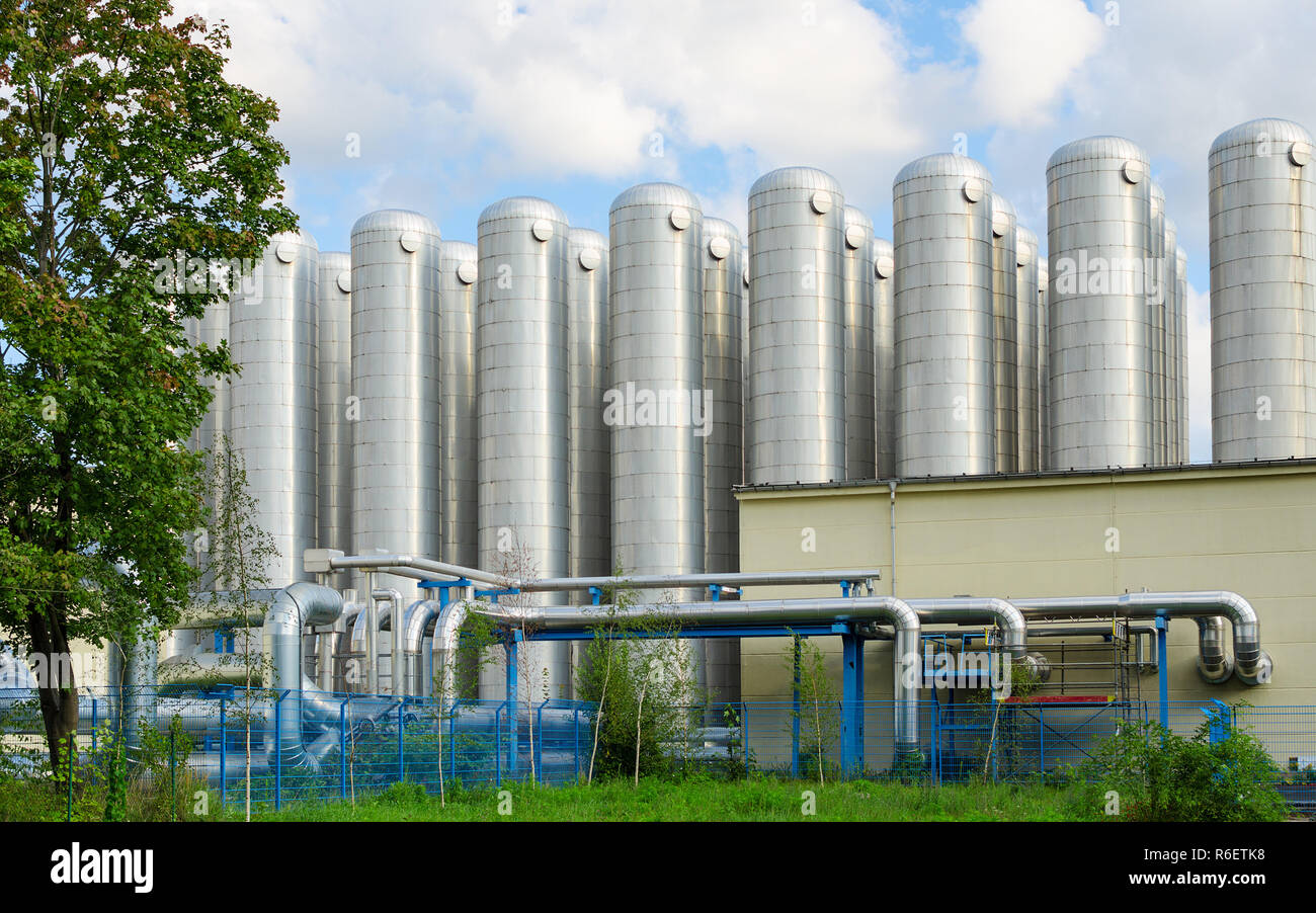 Water storage tanks in eco-friendly industrial sewage treatment system - Stock Image