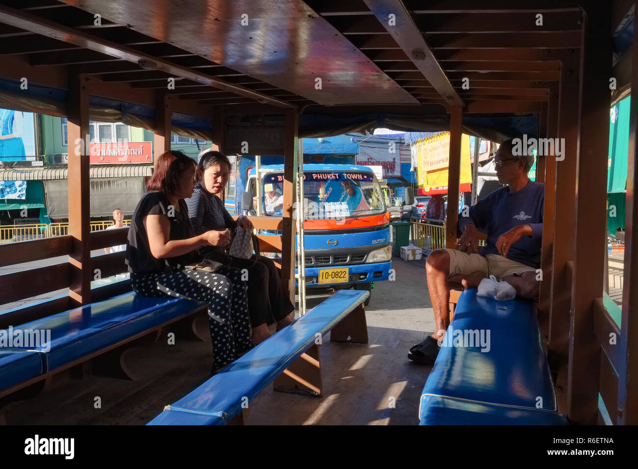 The inside of a songthaew, a typical local bus in Phuket, leaving the market in Phuket Town, Thailand - Stock Image