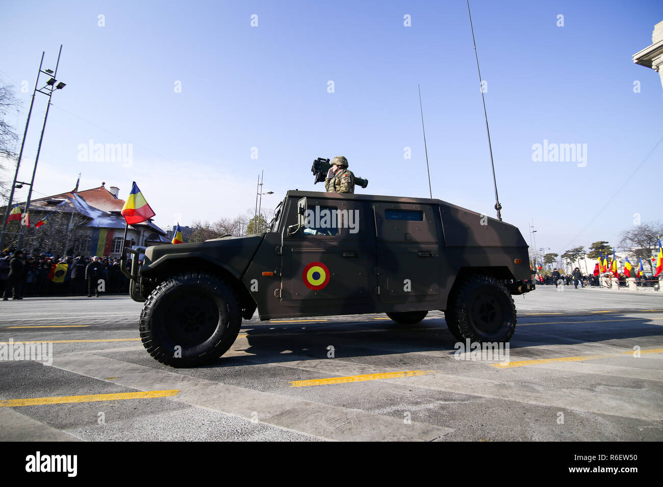 BUCHAREST, ROMANIA - December 1, 2018: URO VAMTAC combat armored vehicle, at Romanian National Day military parade passes under the Arch of Triumph - Stock Image